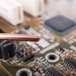 Repairing of computer motherboard, macro view — Stock Photo #65647395