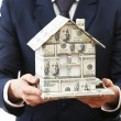 Model of house made of money in male hands isolated on white background — Stock Photo #65649629