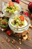 Healthy layered dessert with muesli and fruits on table — Stockfoto