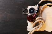Marine still life pipe, compass, rope and sheet of paper on wooden background — Stock Photo
