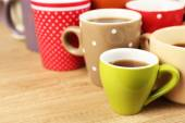 Many cups of coffee on wooden table background, closeup view — Stock Photo