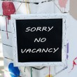 Signboard with text Sorry No Vacancy near hotel — Stock Photo #66118467