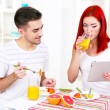 Happy couple has breakfast in kitchen — Stock Photo #66119941