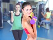 Beautiful young girl doing exercises in gym — Stock Photo