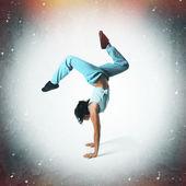 Hip hop dancer portrait on grunge background — Stock Photo
