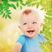Cute baby boy on natural background — Stock Photo
