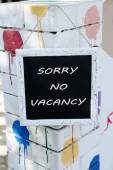 Signboard with text Sorry No Vacancy near hotel — Stock Photo