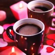 Two cups on table with candles and decor close-up — Stock Photo #66129095