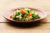 Salad with quail egg and basil — Stock Photo