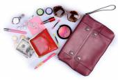 Ladies handbag and things with accessories of it isolated on white — Stockfoto