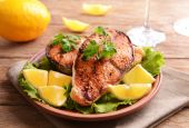 Tasty baked fish on plate on table close-up — Stockfoto
