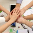 United hands of business team on workspace background top view — Stock Photo #66131295