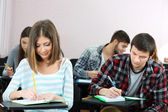 Group of students sitting in classroom — Stock Photo
