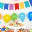 Prepared birthday table with sweets for children party — Stock Photo #66159992