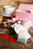Heart shaped teabag tags and box on wooden background — Zdjęcie stockowe