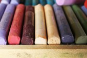 Colorful chalk pastels in box close up — Stock Photo