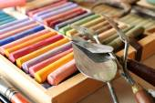 Colorful chalk pastels in box with palette knifes close up — Stock Photo