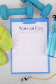 Workout plan and sports equipment top view close-up — Stock Photo