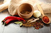 Different kinds of spices on wooden background — Stock Photo