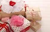 Beautiful gift boxes on wooden background. Valentine Day concept — Stockfoto