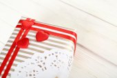 Beautiful gift box on wooden table. Valentine Day concept — Stock Photo