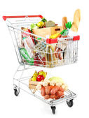 Shopping cart full with various groceries isolated on white  — 图库照片
