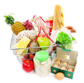 Metal shopping basket with groceries isolated on white — Stock Photo