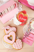 Heart shaped cookies for valentines day on plate, on color wooden background — Foto de Stock