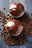 Composition with tasty homemade chocolate muffins and coffee beans — Stock Photo