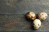 Bird eggs on wooden background — Stock Photo