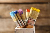 Brushes with colorful paints — Stock Photo