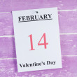 Valentines Day, February 14 on calendar on wooden background — Stock Photo #66902233