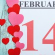 Valentines Day, February 14 on calendar on wooden background — Stock Photo #66902243