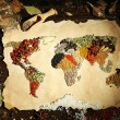 Map of world made from different kinds of spices on wooden background — Stock Photo #66903285