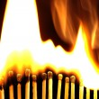 Line of lighted matches on black background — Zdjęcie stockowe #66903375