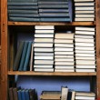 Many books on bookshelf in library — Stock Photo #66908271