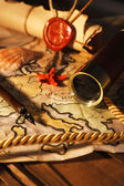 Marine still life with world map on wooden table background — Stock Photo