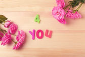 "Beautiful roses with phrase ""4 You"" on wooden table background — Stock Photo"