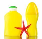 Bottles of suntan cream with sea star isolated on white — Stock Photo