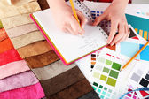 Woman working with scraps of colored tissue and palette close up — Stock Photo