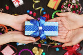 Female hands holding gift close-up — Stock Photo