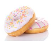 Delicious donuts with icing isolated on white — Stock Photo