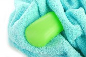 Terry towel with soap isolated on white — Stock Photo