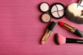 Set of colorful cosmetics on pink wooden table background — Stok fotoğraf