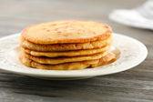 Tasty fritters on plate on table close up — Stock Photo