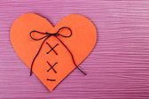 Stitched heart on colour background — Stock Photo