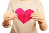 Woman holding broken heart stitched from two pieces close up — Stock Photo