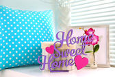 Home in colorful letters in light white interior — Stock Photo