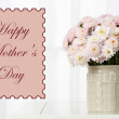 Beautiful flowers in cup on window background, Mother's Day concept — Stock Photo #67067863