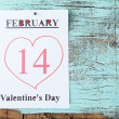 Valentines Day, February 14 on calendar on wooden background — Stock Photo #67202729